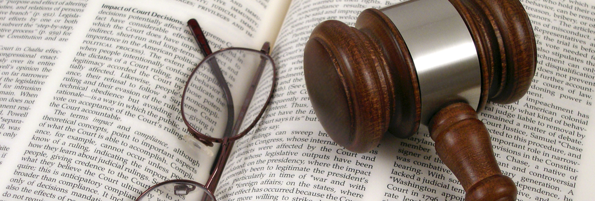 Gavel And Legal Book With Eyeglasses